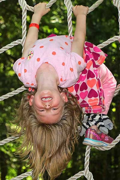 girl upside down on web